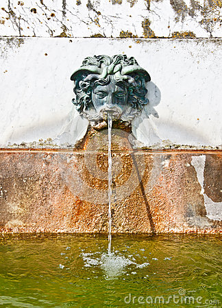 Fountain in the garden of fontainebleau palace