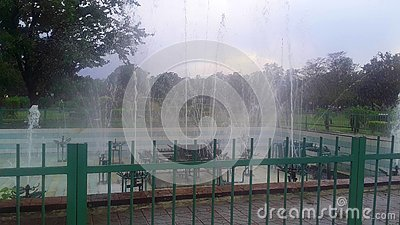 Fountain in the green park Stock Photo