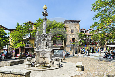 Fountain in the medieval village of Comillas in Spain Editorial Photo