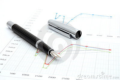 Fountain pen on business chart