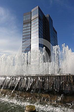Fountain before skyscraper