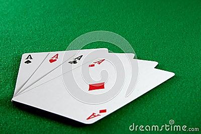 Four aces on card table
