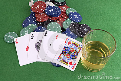 Four Aces on chips and and glass of whisky