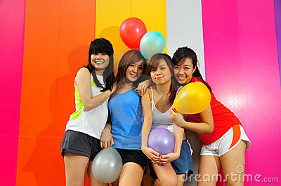 Four Beautiful Girlfriends posing with balloons