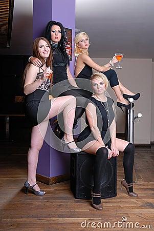Four beautiful girls in bar