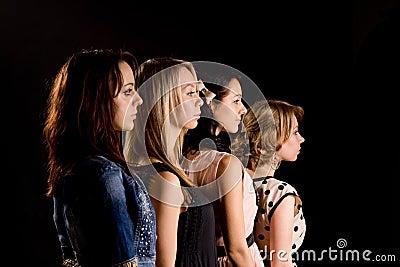 Four beautiful teenage girls in profile