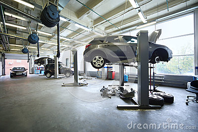 Four black cars in garage with special equipment
