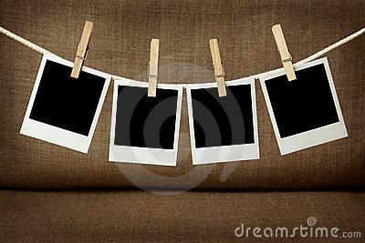 Four blank instant photos