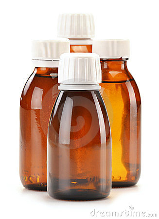 Four bottles of syrup medication on white
