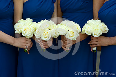 Four bridesmaids holding wedding bouquets