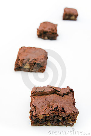 Four brownies on a white background