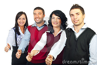 Four business people giving thumbs