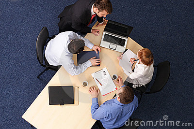 Four business people meeting