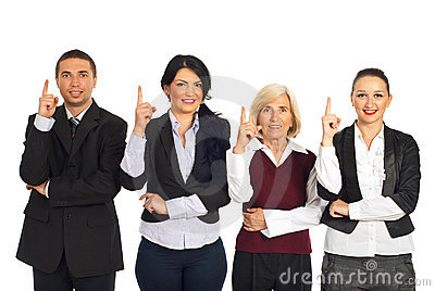 Four business people pointing up