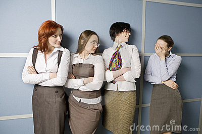 Four businesswoman standing in line