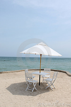 Four chairs and umbrella