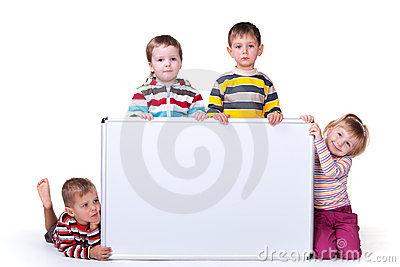 Four children holding a white board
