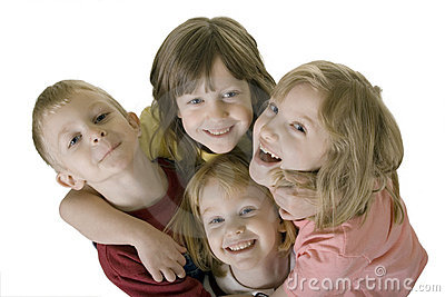 Four children hugging from above