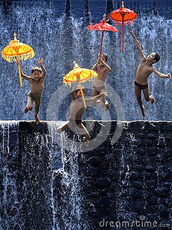 Free Four Children Jump With Umbrellas Stock Photography - 99900832