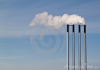 Four chimneys on a blue sky