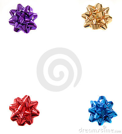 Four colorful Christmas bows in the four corners of an isolated
