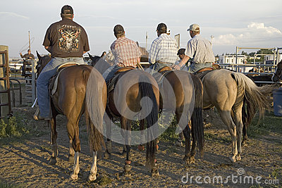 Four cowboys at PRCA Rodeo Editorial Photo