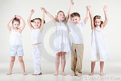 Four cute little girls and one boy hold on hands up