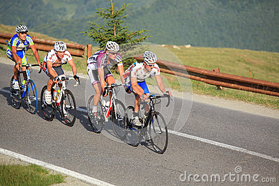 Four cyclists climbing mountains at Sibiu Cycling Tour 2012 Editorial Stock Image
