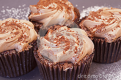 Four delicious chocolate cupcakes