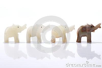 Four dwarf elephant statuettes