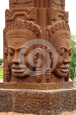 The four faces of buddah statue in sandstone. phnom penh, cambodia.