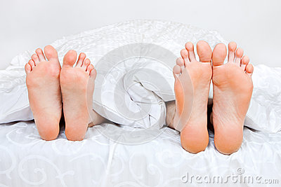 Four feet in a bed