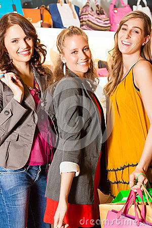 Free Four Female Friends Shopping Bags In A Mall Stock Photography - 26487002