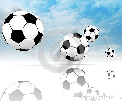 Four football balls on clear spacious field