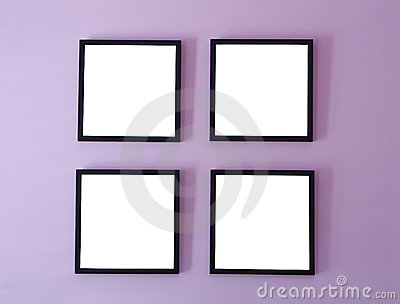 four blank picturephoto frames on wall