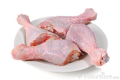 Four fresh raw chicken legs