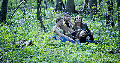 Four girls in forest