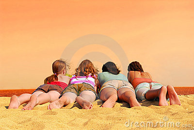 Four girls at orange sea