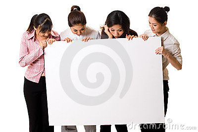 Four girls with a white sign