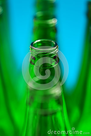 Four green bottles in one row.