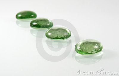 Four green glass pebbles
