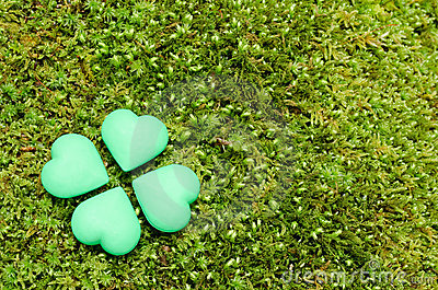 Four green heart objects