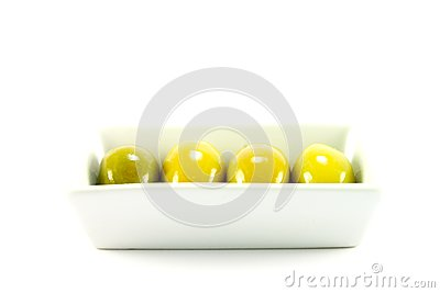 Four Green Olives in a Dish