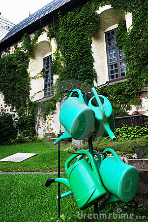 Four green watering can