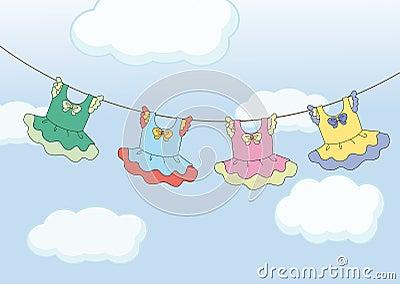 Four hanging dresses