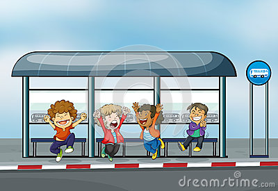 Four happy kids at the waiting shed