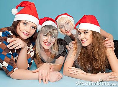 Four happy women lying on the floor