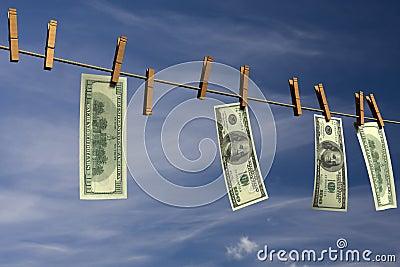 Four hundred dollar bills hanging on a clothesline
