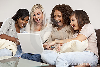 Four Interracial Girlfriends Laughing at Laptop C