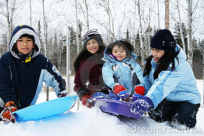 Four kids enjoying winter